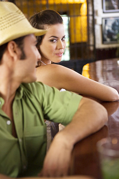 Man and woman flirting in bar, dating, picking up women