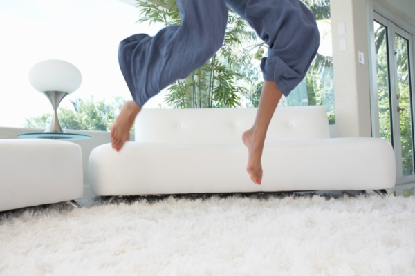 woman jumping in her living room
