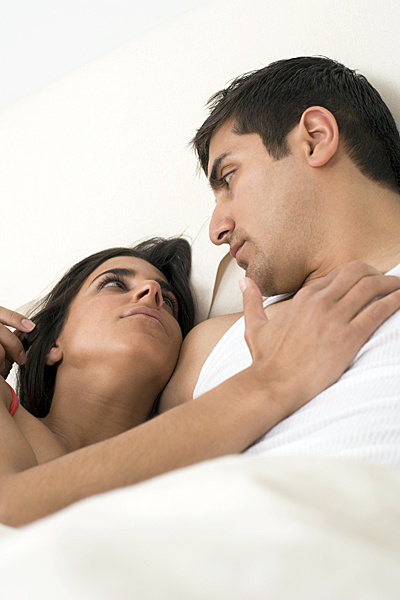 Man above woman in bed, sexy