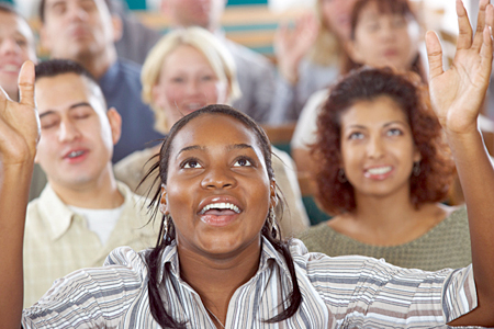 Woman singing in exultation at church