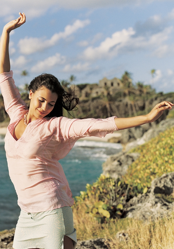 woman happy and dancing with arms out. Open