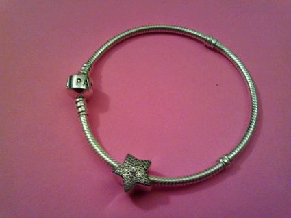 """This is the bracelet I won at Christmas time. The charm is called """"Wishing Star,"""" and I have been wearing it everyday since the breakup -- to remind myself to keep wishing. After I made my wish tonight, I looked down and thought, """"it is so."""""""